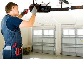 Garage door opener repair man working
