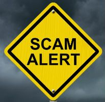 Garage door company scam alert street sign